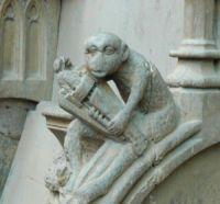 appuie-main singe jouant de la vielle à roue